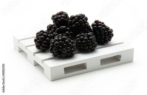 Fényképezés  Blackberries on pallet isolated on white background.