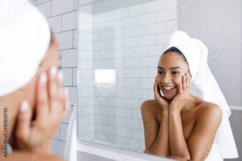 Portrait a beautiful young woman with  healthy skin touching her face Fototapeta