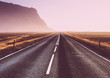 Road through iceland landscape. Road and car travel scenic and sunset.Road travel concept.Car travel adventure
