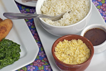 Accompaniments Of Feijoada Served At The Table