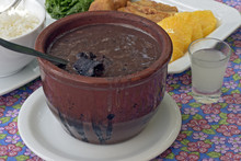 Feijoada Served At The Table With Its Typical Accompaniments