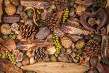 Christmas Potpourri Background. Traditional Decoration Of Pinecones Nuts And Berries