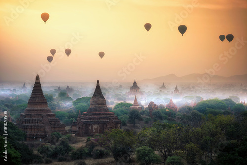 Hot air balloon over plain of Bagan in misty morning, Mandalay, Myanmar Wallpaper Mural