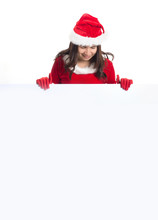Woman In Santa Dress Holding A...