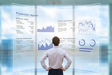Businessman Analyzing Financia...