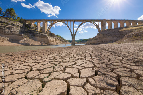 landscape of dry earth ground and viaduct, extreme drought in Entrepenas reservoir, in Guadalajara, Castilla, Spain Europe
