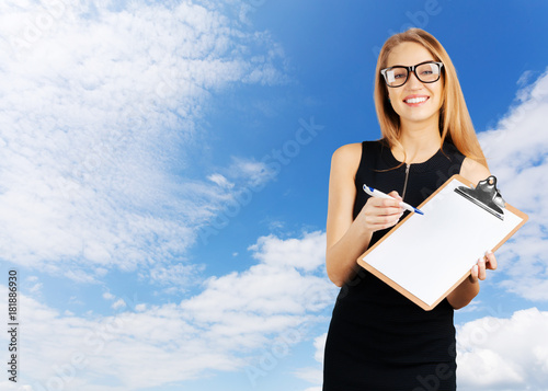 Poster  Businesswoman holding a clipboard