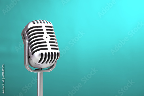 Fotografie, Obraz  Retro microphone with turquoise wall background