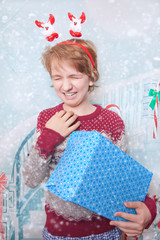 Unhappy Emotional Angry Child Boy with Christmas Gift Box Alone
