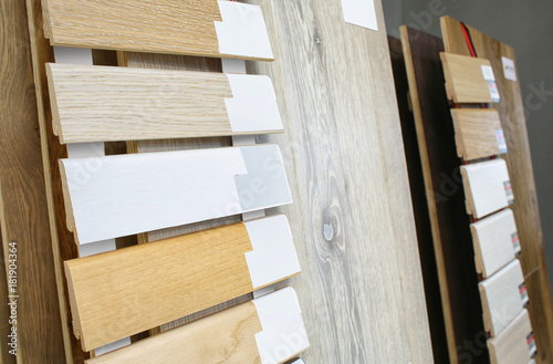 Photo Assortment of baseboard molding and flooring samples in shop