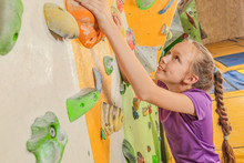 Cute Little Girl Climbing On W...