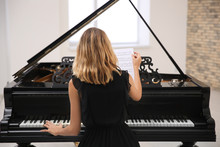Talented Woman Playing Piano I...