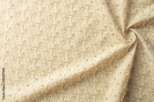 Beige fabric with punctured circles  Beige background  Abstract