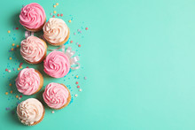 Many Yummy Cupcakes On Color Background