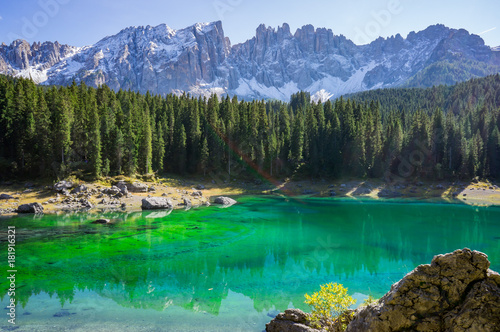 Beautiful view alpine lake with mountains in the Dolomites in South Tyrol, Italy.  Lago di Carezza, Karersee.
