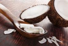 Coconut Oil In Spoon On Wooden...