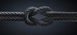 Kreuzknoten mit dunklem Seil vor dunklem Hintergrund