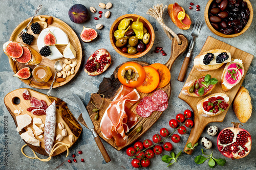 Fotografering  Appetizers table with italian antipasti snacks