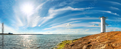 Fototapeten Leuchtturm Panoramic image of a seaside by lighthouse in Swinoujscie, Poland