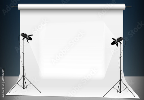 Obraz Photo studio with a light and blank background. Lighting with two studio flashlights. Supports for photographic equipment. Copy space. - fototapety do salonu
