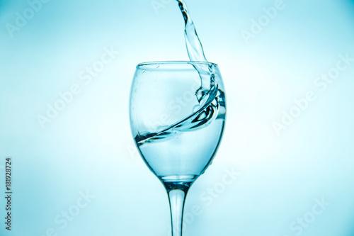 Papiers peints Eau Wineglass with splashing drops of fresh water
