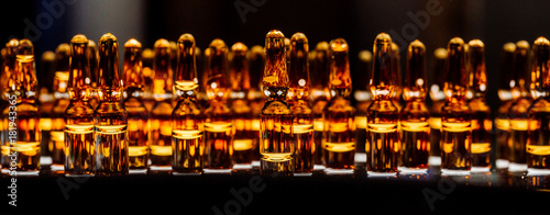 production of medicines. lot of ampoules on light background. Canvas Print