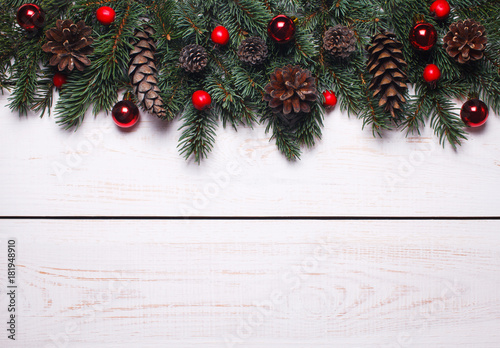 christmas white wood background with fir branches and fir cones place for text christmas