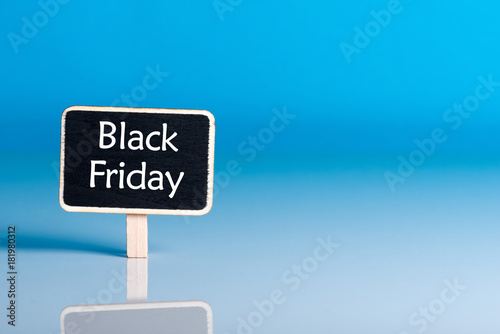 Poster  Black Friday shopping sale concept with little wooden tag