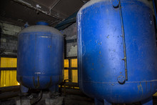 Rusty Industrial Containers For Nitric Acid In Abandoned Factory