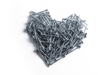A Heart Of Metal Nails On A Wh...