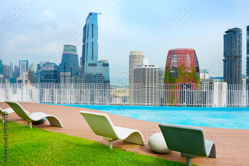 Rooftop deck chairs. Singapore Downtown
