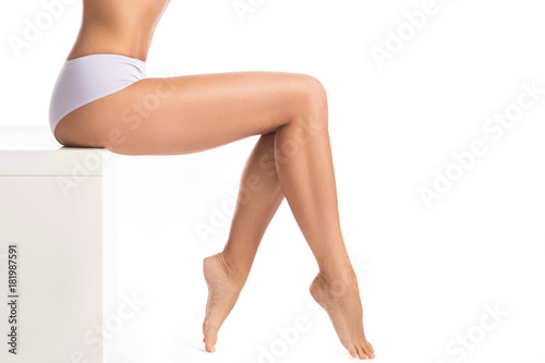 Valokuva Female legs on white background