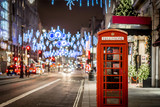 Fototapeta Londyn - Phone box in London in Christmas time