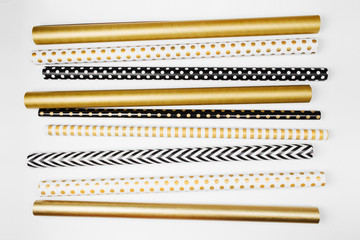Christmas collection wrapping paper in gold and black colors. View from above. Flat lay