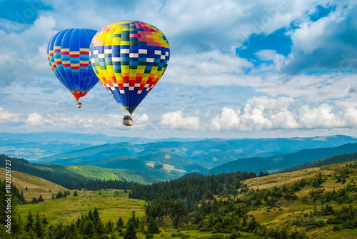 Aluminium Prints Balloon Colorful hot-air balloons flying over the mountains. Artistic picture. Beauty world.