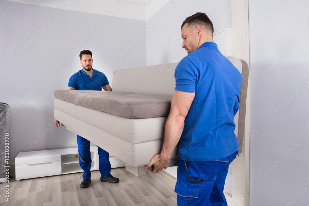 Fototapety, obrazy: Two Men Holding Sofa In Living Room