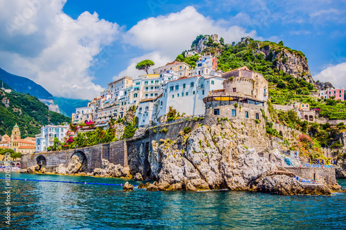 The small haven of Amalfi village with the tiny beach and colorful houses, located on the rock, Amalfi coast, Italy Wallpaper Mural