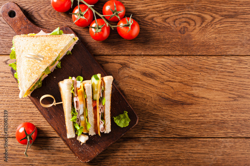 Staande foto Snack Delicious toast sandwich with ham, cheese, egg and vegetables.
