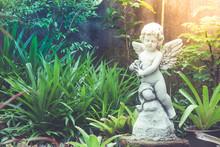 White Cupid Sculpture Or Statu...