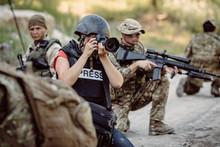 Photojournalist Documenting Wa...