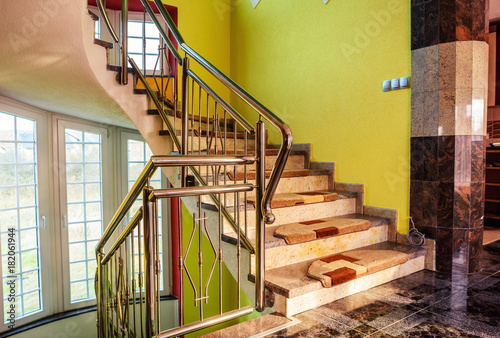 Photo Stands Stairs granite staircase in the house with chrome fence - stainless steel fence