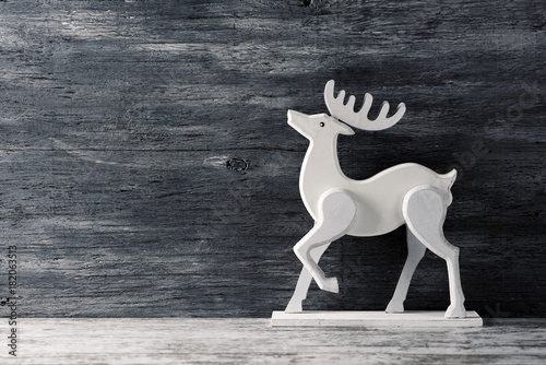 white wooden reindeer Poster