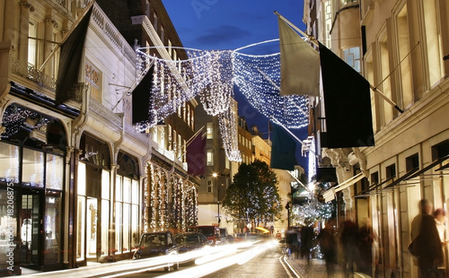 UK - Cities - Christmas Shopping Street in London, motion blurred people present Wallpaper Mural