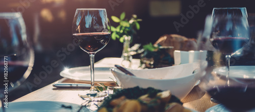 Glass of wine at dining table - 182068771