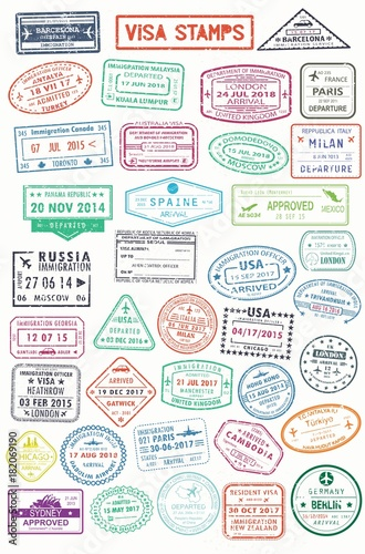 Fotografie, Obraz  Passport stamps or visa pages for traveling abroad