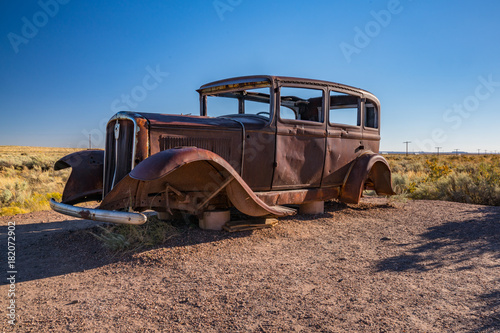 Abandoned Car in Petrified Forest National Park along Route 66 in Arizona Poster