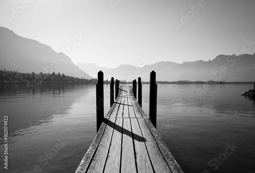 Staande foto Grijs black and white wooden bridge