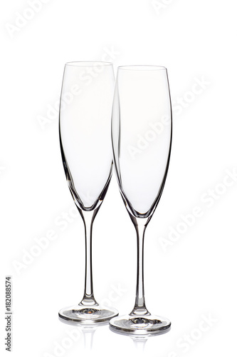 Two empty champagne glasses on white