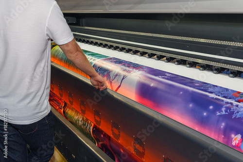 Fototapeta Large-format printing machine in the printing house. Industry obraz