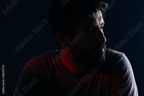 Foto  Dramatic portrait of bearded man